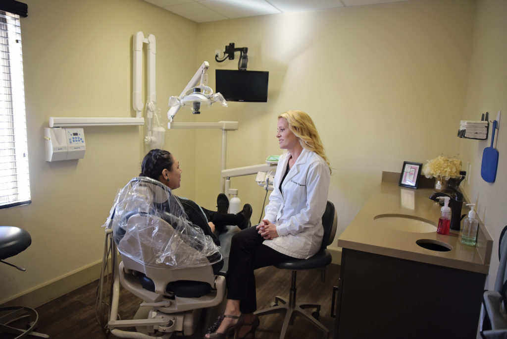 Brooklyn Cambron-Hagerman, DMD consults with a patent who came in for an emergency dentist visit because of a cracked tooth.